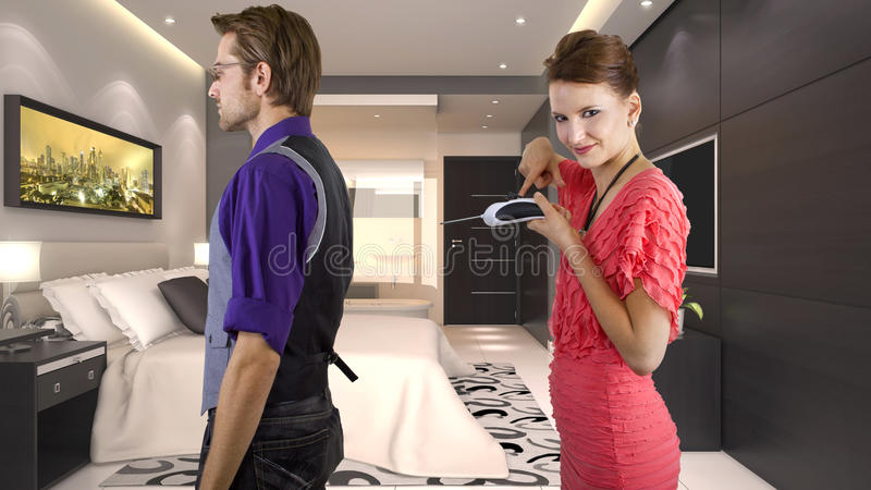 In Control Concept. Young women controlling her boyfriend with a remote control royalty free stock images