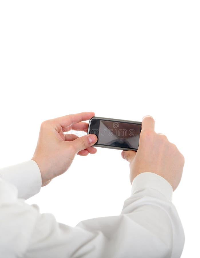 Control de la persona un teléfono móvil foto de archivo