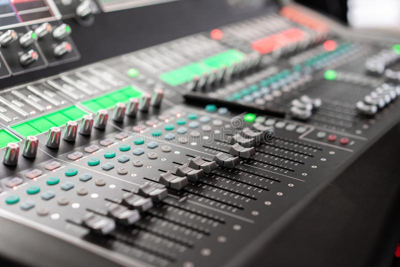 Control Fader. Mixing console of light equipment operator at the concert. Sound recording studio mixing desk with royalty free stock photography