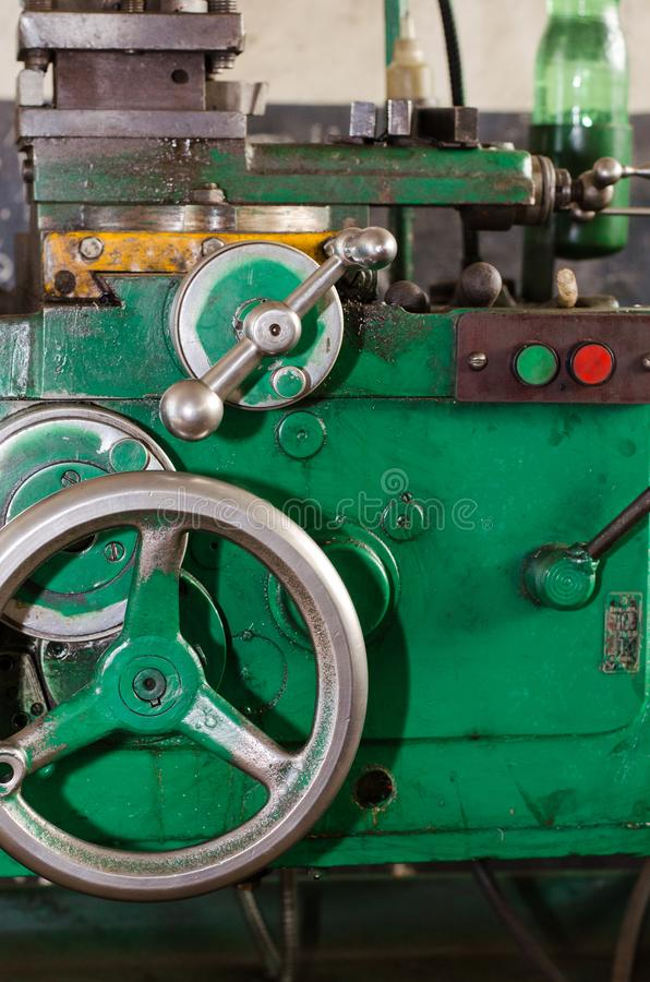 Control knob for longitudinal movement of the slide on a lathe royalty free stock photo