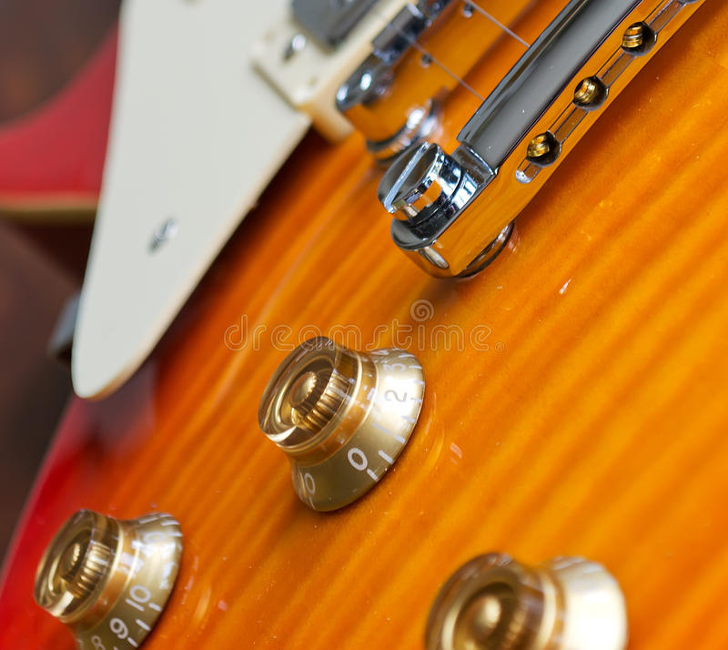 Control knobs. Closeup of a guitar bridge with control knobs stock images