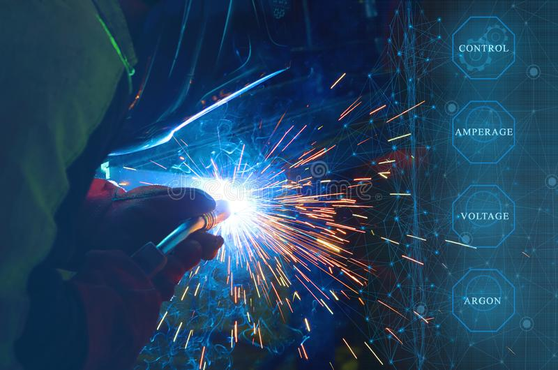 Control of the main parameters of welding in a protective gas environment carried out by an artificial intellect and the use of th. E Internet of things for the royalty free stock images