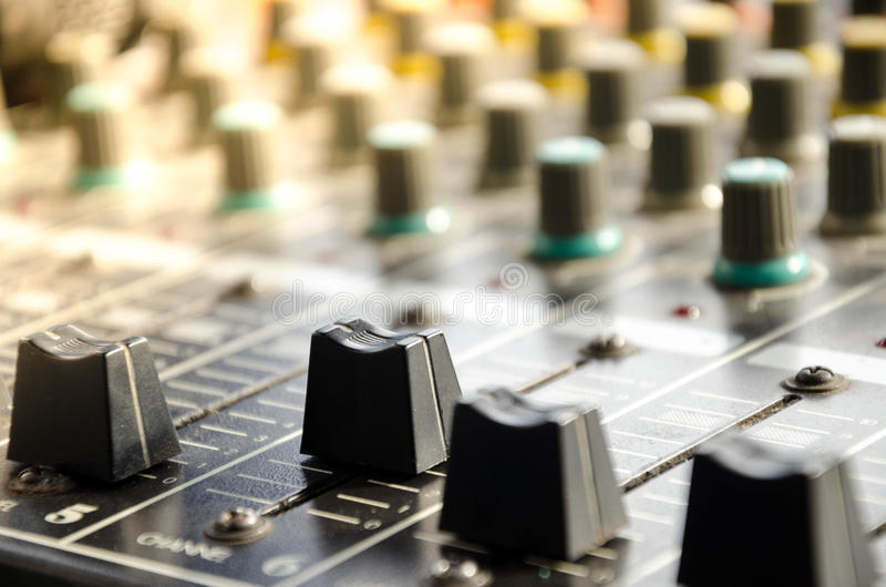 Control Panel Of Analog Studio Mixer. The audio equipment, control panel of analog studio mixer, front view. Close-up, selected focus royalty free stock images
