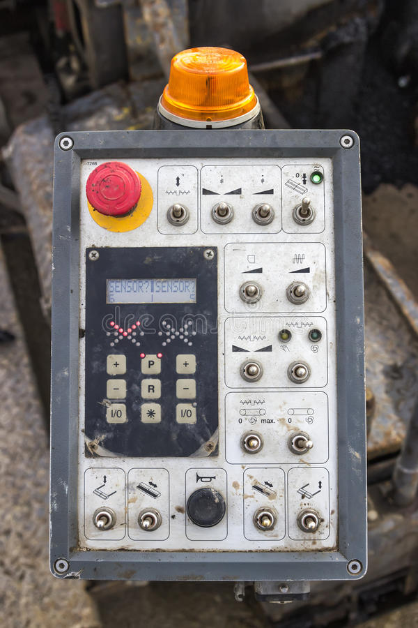 Control panel of asphalt paving machine stock photography