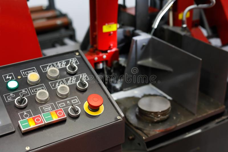 Control panel of CNC metal cutting band saw. Control panel of automatic CNC metal cutting band saw. Selective focus stock images