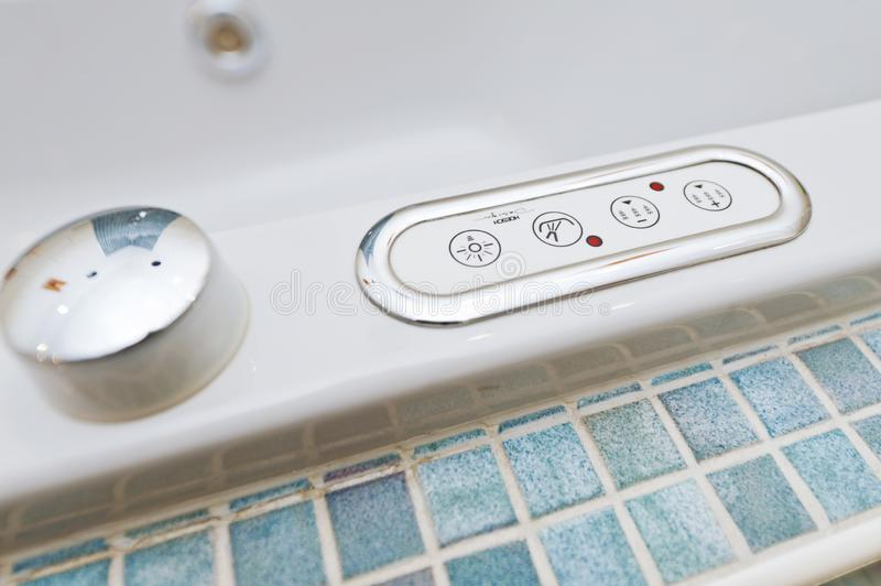 Control panel on bathtub with buttons. Control panel with multiple buttons on bathtub with different functions stock photo