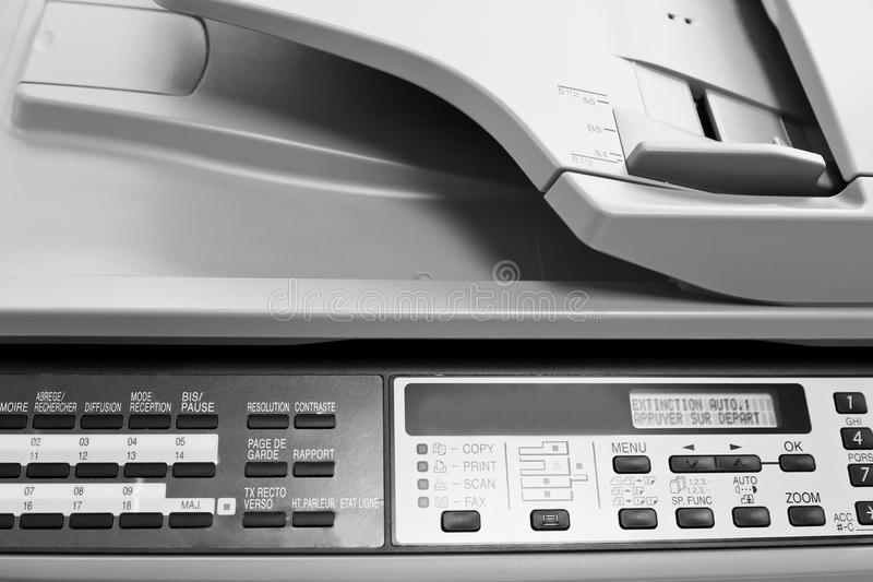 Control panel of big copier. Metal control panel of big copier close up stock photography