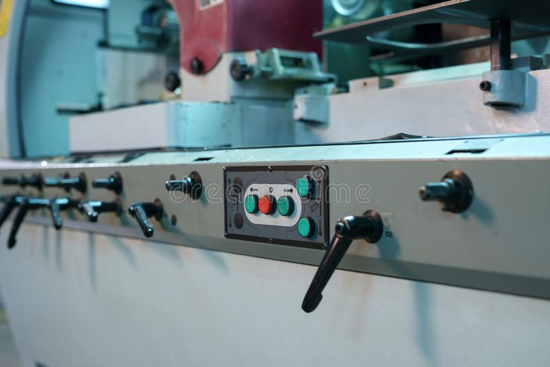 Control panel with buttons and levers on machine stock images