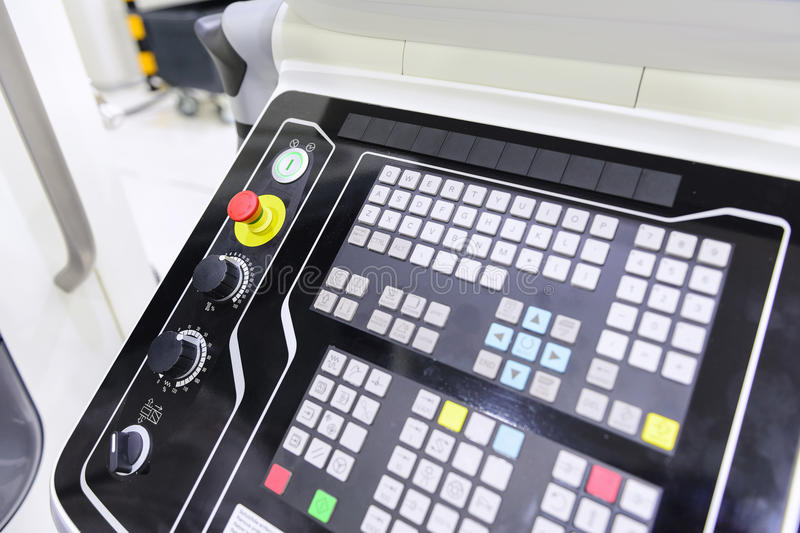 The control panel of CNC machine. The emergency button or emergency knob of CNC milling machine with the control panel.The control panel of CNC milling machine royalty free stock images