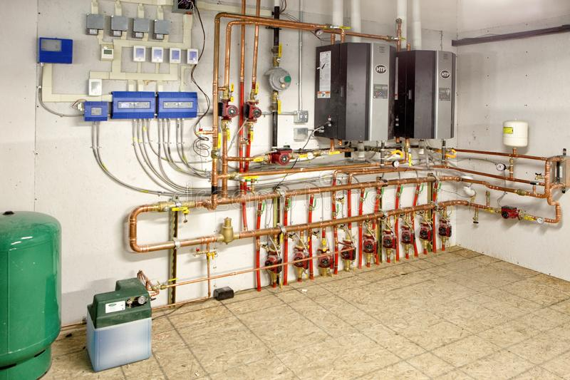 Energy efficient heating control panels. The control panel of an energy efficient in floor radiant heating system, in a new modern automotive repair shop stock photo