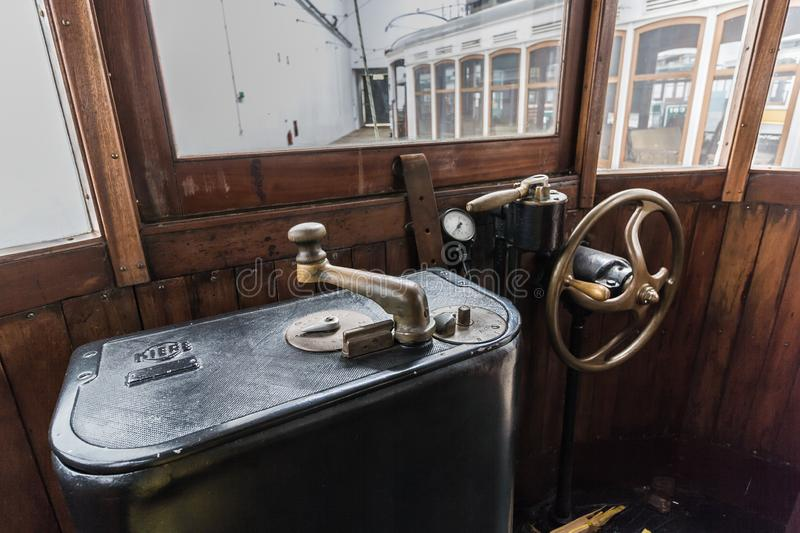 Metal control lever in an old tram. control panel inside old funicular railway tram with curved wooden handle. Control panel inside old funicular railway tram stock photo