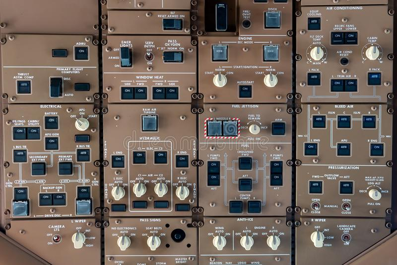 Control panel knobs and buttons in a big jet plane. Cockpit royalty free stock image