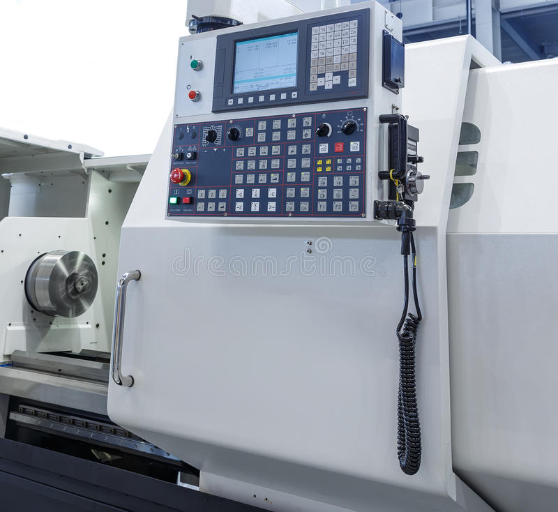 Control panel of the modern lathe with CNC stock photo