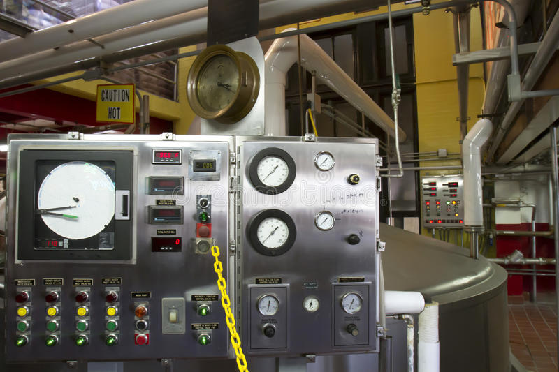 Control Panels in Factory. Control equipment for brewery on factory floor stock photos