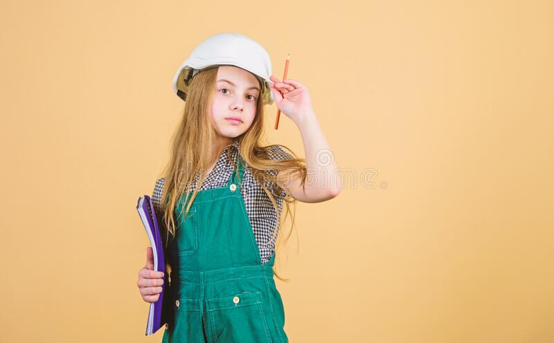 Control renovation process. Kid happy renovating home. Home improvement activity. Kid girl planning renovation. Child royalty free stock image