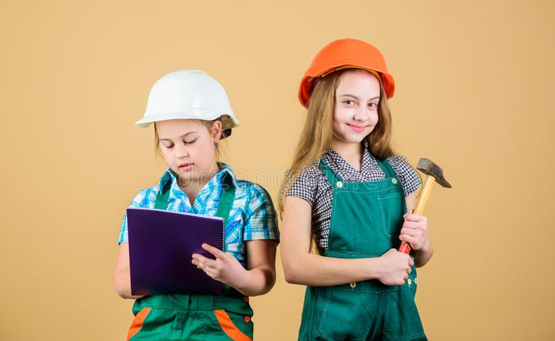 Control renovation process. Kids happy renovating home. Home improvement activity. Kids girls with tools planning stock photography