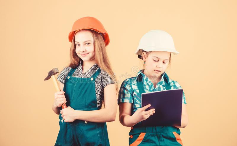 Control renovation process. Kids happy renovating home. Home improvement activity. Kids girls with tools planning royalty free stock images
