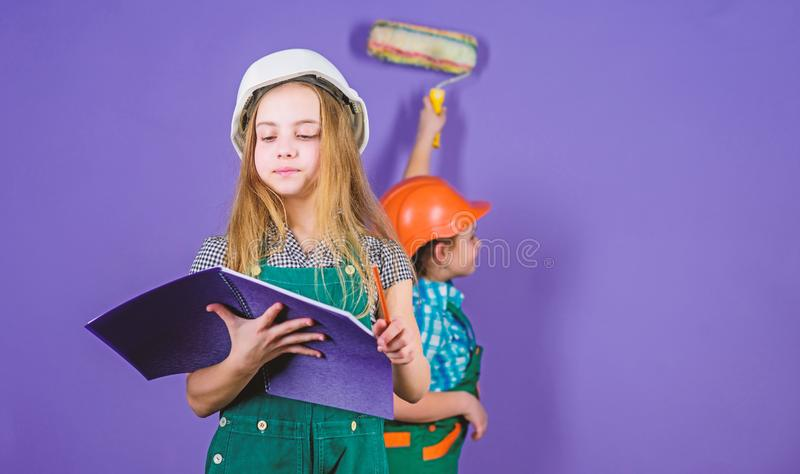 Control renovation process. Sisters happy renovating home. Home improvement activity. Kids girls planning renovation. Repaint walls. Move in new apartment stock image