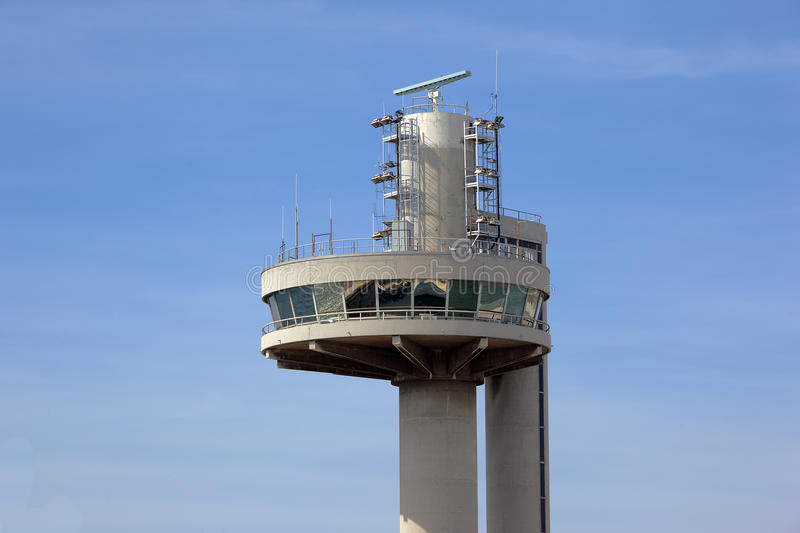 Control tower. Large control tower over blue sky stock photos