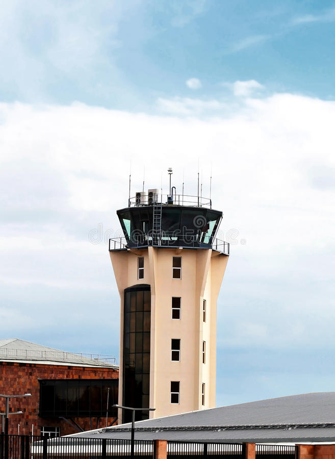 Control tower. Air traffic control tower of the airport with radio and radar facilities and optical surveillance devices royalty free stock photography