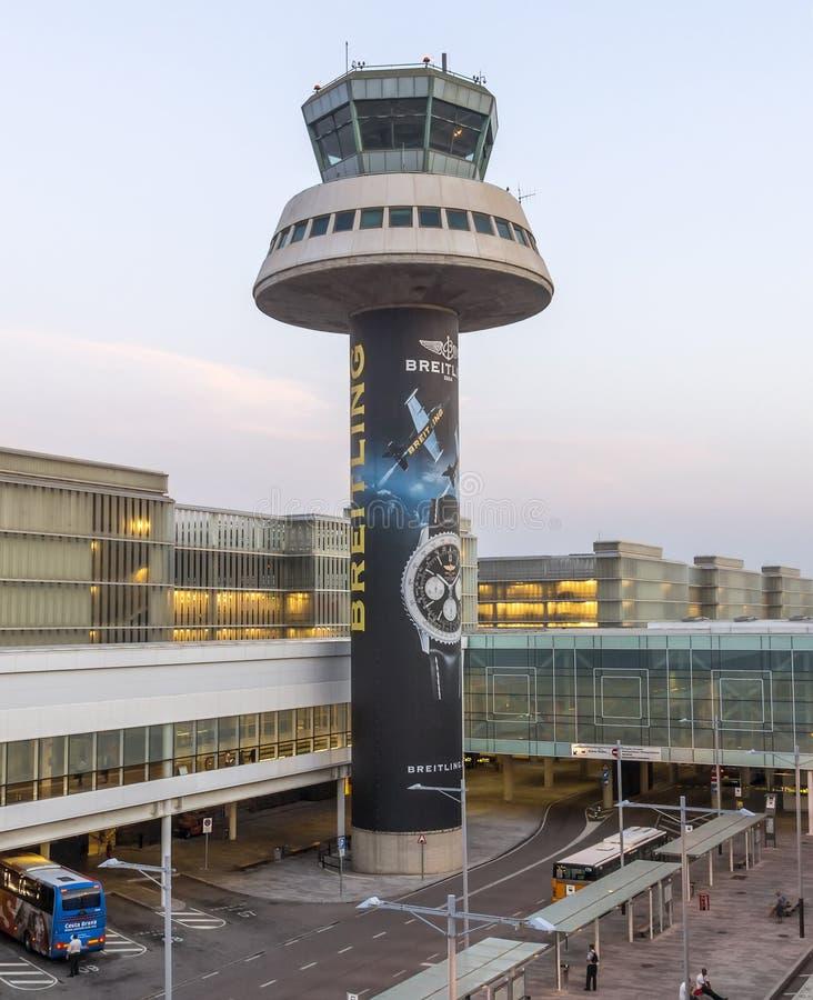 Control tower of El Prat-Barcelona airport. BARCELONA, SPAIN - JULY 16, 2015: The control tower of El Prat-Barcelona airport. This airport was inaugurated in stock photo