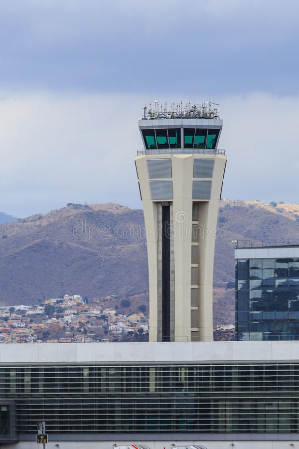 Control tower with mountains. Airport control tower of Malaga, Spain, with mountains in the background stock photo