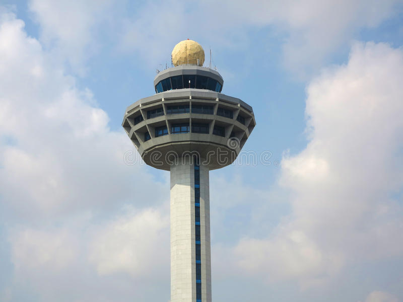 Control Tower. Over blue sky and white cloud royalty free stock photo