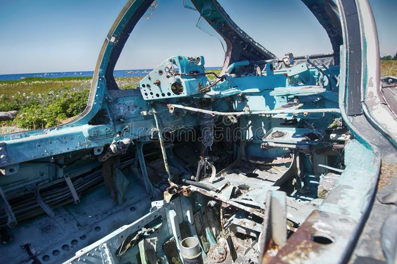 Control units made of aluminum alloy in cockpit of crashed aircraft. Control units made of aluminum alloy in cockpit of crashed military aircraft. pipes, wiring stock photography