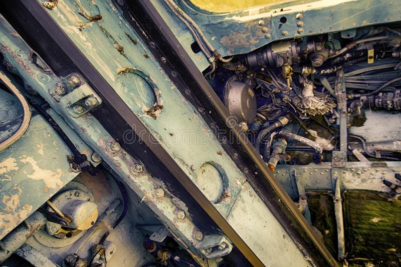 Control units made of aluminum alloy in cockpit of crashed aircraft. Control units made of aluminum alloy in cockpit of crashed military aircraft. pipes, wiring stock images
