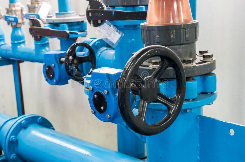 Control wheel of the centrifugal water pump. Control wheel of the centrifugal water pump for distribution the water supply in the water filtration plant royalty free stock photo