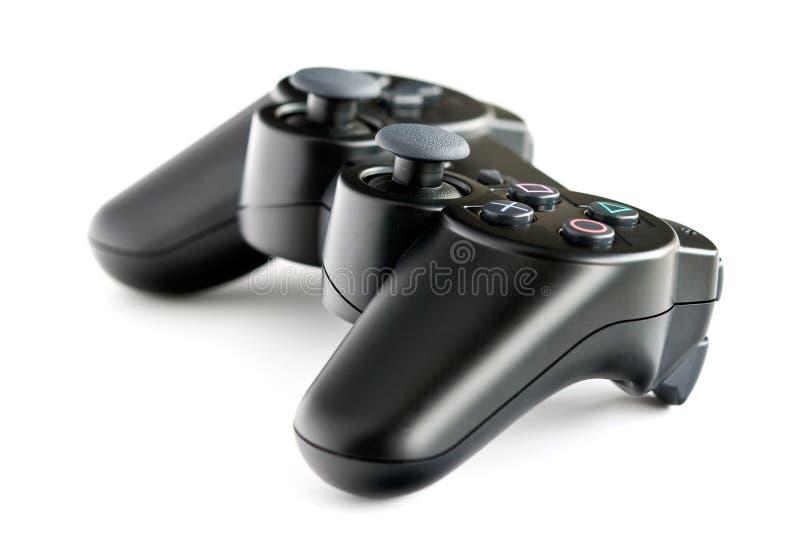 Controlador sem fio preto do jogo do console fotografia de stock