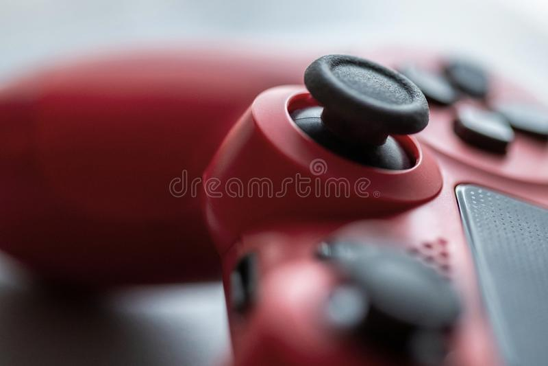 Controlador vermelho do jogo em detalhe fotografia de stock royalty free