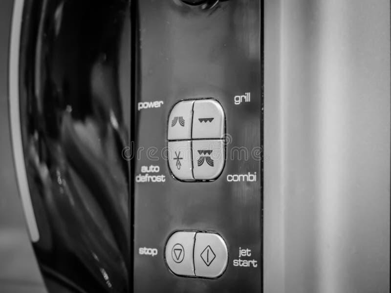 Controle botões na micro-ondas foto de stock