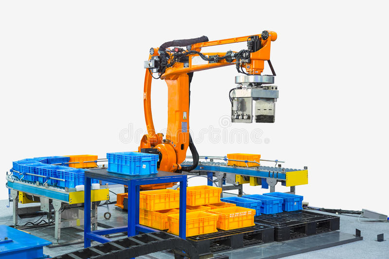Controller of industrial robotic arm for performing, dispensing, material-handling and packaging applications in production line. Manufacturer factory. With royalty free stock photos