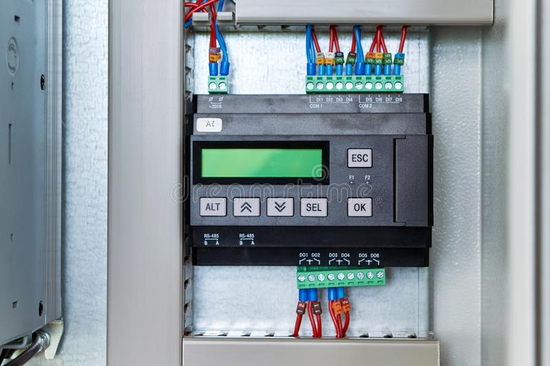Controller or logic control relay in electrical Cabinet royalty free stock photos