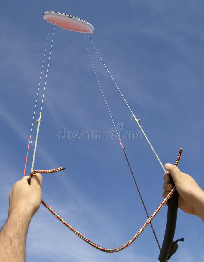 Controlling high flying kite royalty free stock photo