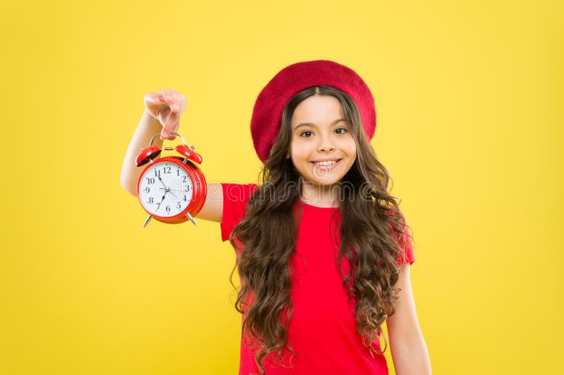 Controlling personal time. Schedule and time. Set up alarm clock. Child little girl hold red clock. Always on time. It stock images