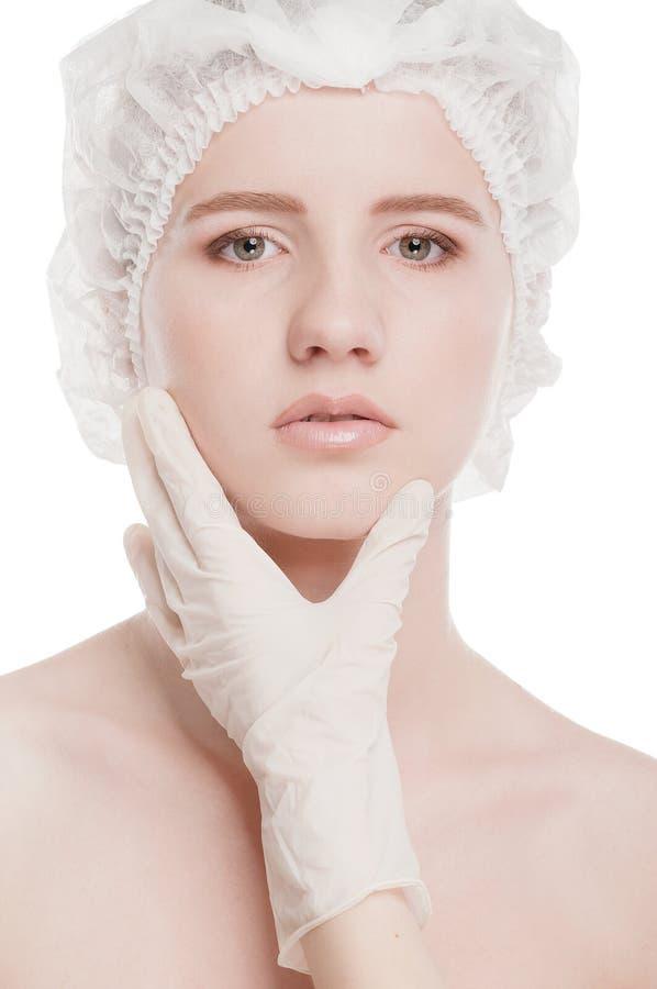 Controlo médico da face da mulher bonita foto de stock