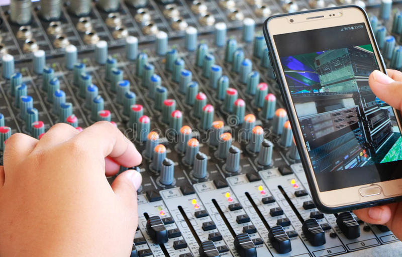 Controls of audio mixing console and phone royalty free stock photography