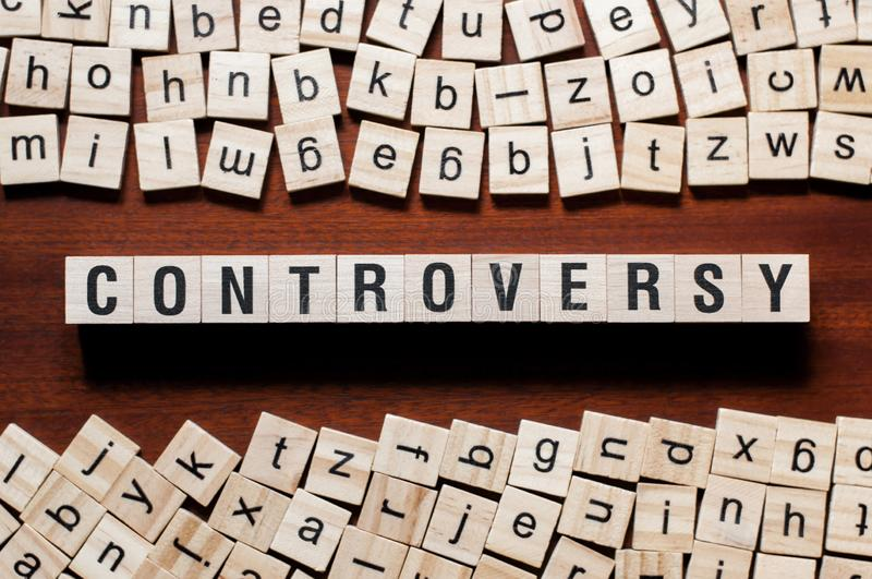 Controversy word concept on cubes stock image