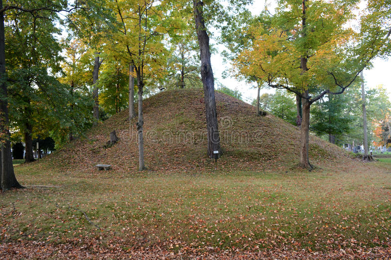 Conus. Is the name given this mound built by ancient native American i.dians known as Mound Builders. A burial mound situated in Marietta Ohio surrounded by a royalty free stock photography