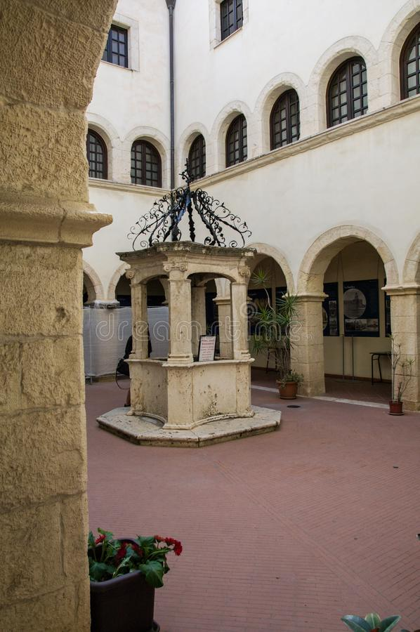 Sardinia. Cagliari. Sanctuary of Nostra Signora di Bonaria. Convent of the Mercedarian Fathers.  The beautiful well in the center of the small cloister of the royalty free stock images