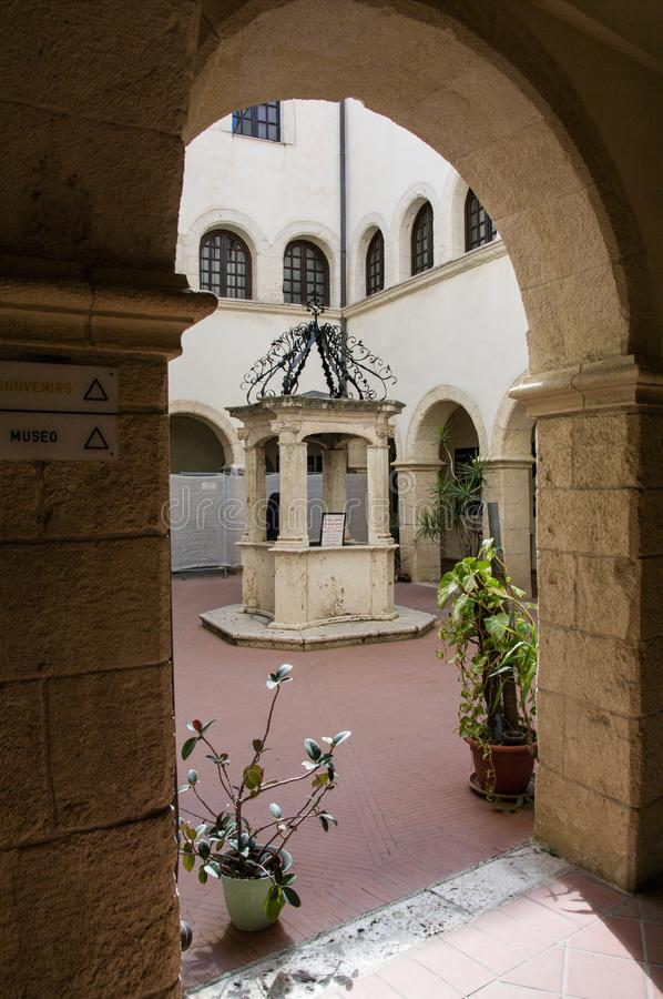 Sardinia. Cagliari. Sanctuary of Nostra Signora di Bonaria. Convent of the mercedarian fathers.  the beautiful well in the center of the small cloister of the royalty free stock image
