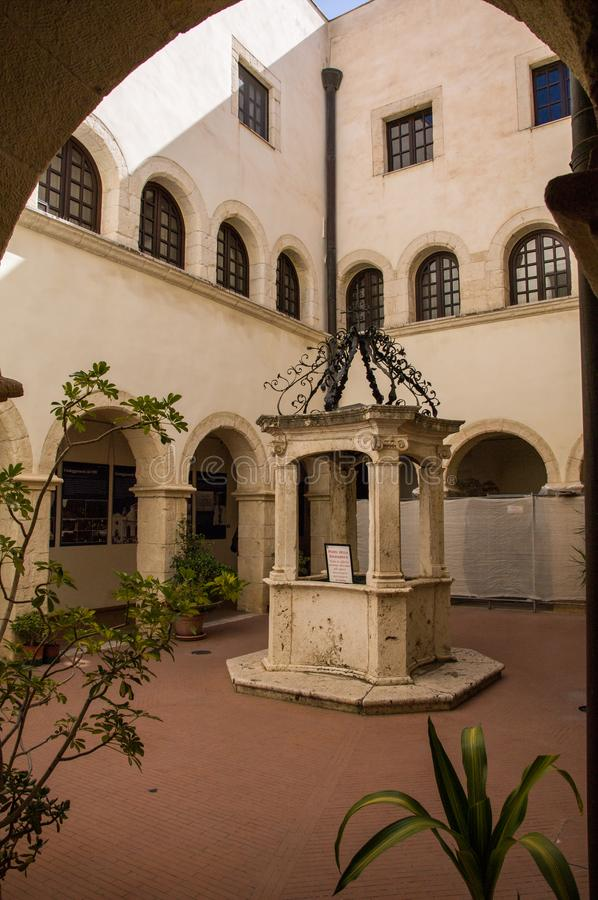 Sardinia. Cagliari. Sanctuary of Nostra Signora di Bonaria. Convent of the mercedarian fathers.  the beautiful well in the center of the small cloister of the royalty free stock photo
