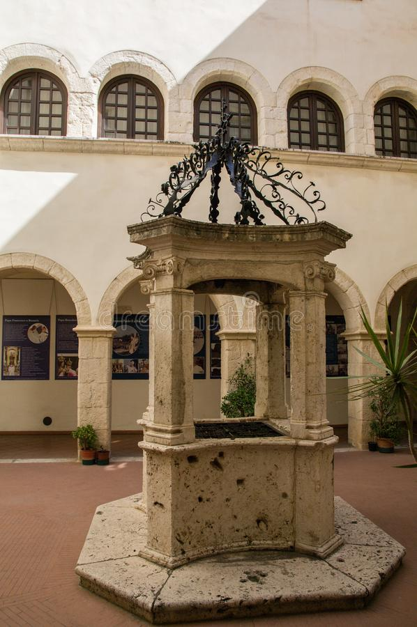 Sardinia. Cagliari. Sanctuary of Nostra Signora di Bonaria. Convent of the mercedarian fathers.  the beautiful well in the center of the small cloister of the stock images