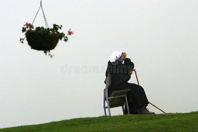 Convent sisters in mountains stock image