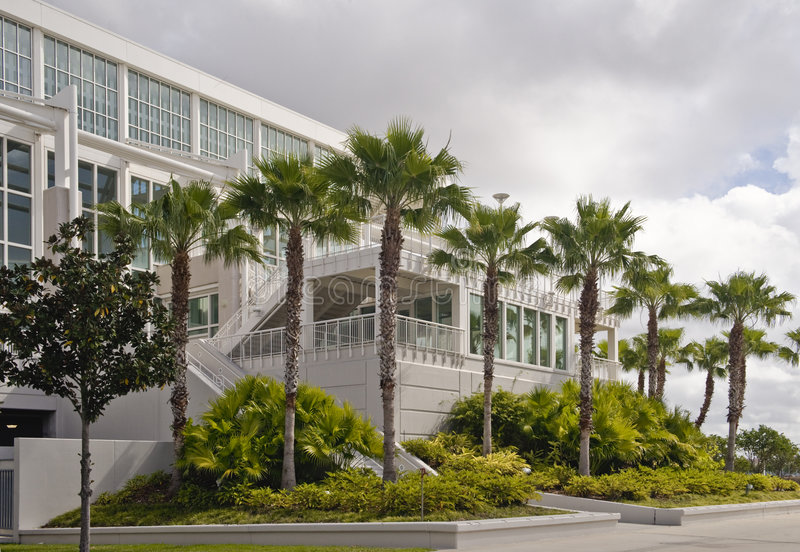 Convention Center Building. The front of the orange County Convention Center Building in Orlando, Florida with palm trees and landscaping royalty free stock image