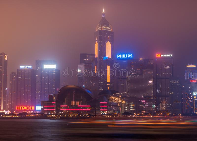 Convention Center and Central Plaza tower night skyline Hong Kong Island, China stock photo
