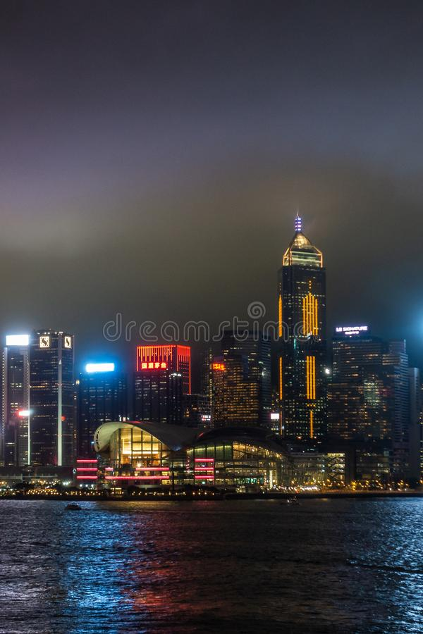Convention Center on Hong Kong Island skyline during rainy night, China stock images