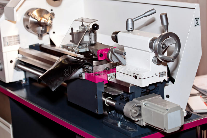 Conventional Precision Lathe machine. With servo drive - easy to operate, more reliable, more precise, for higher loads and reduced maintenance stock images